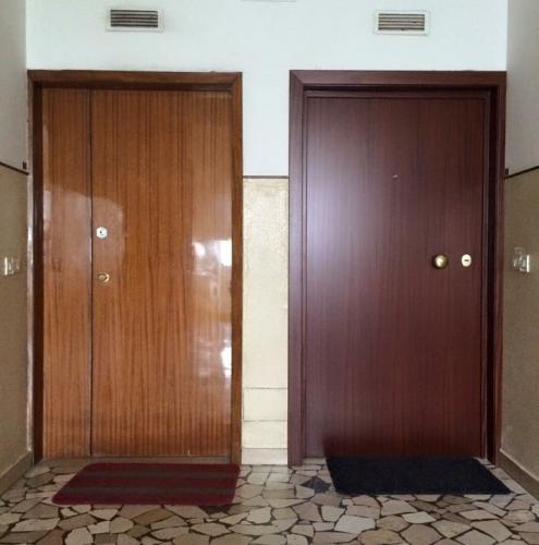 14 Vignali Simone Infissi-Style Porta blindata style legno
