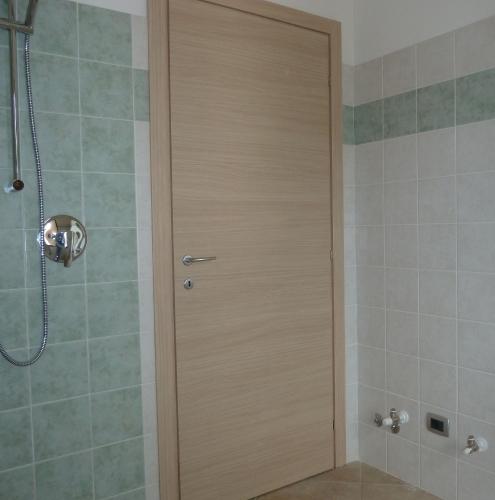 12 Vignali Simone Infissi-Style Porta interna style legno